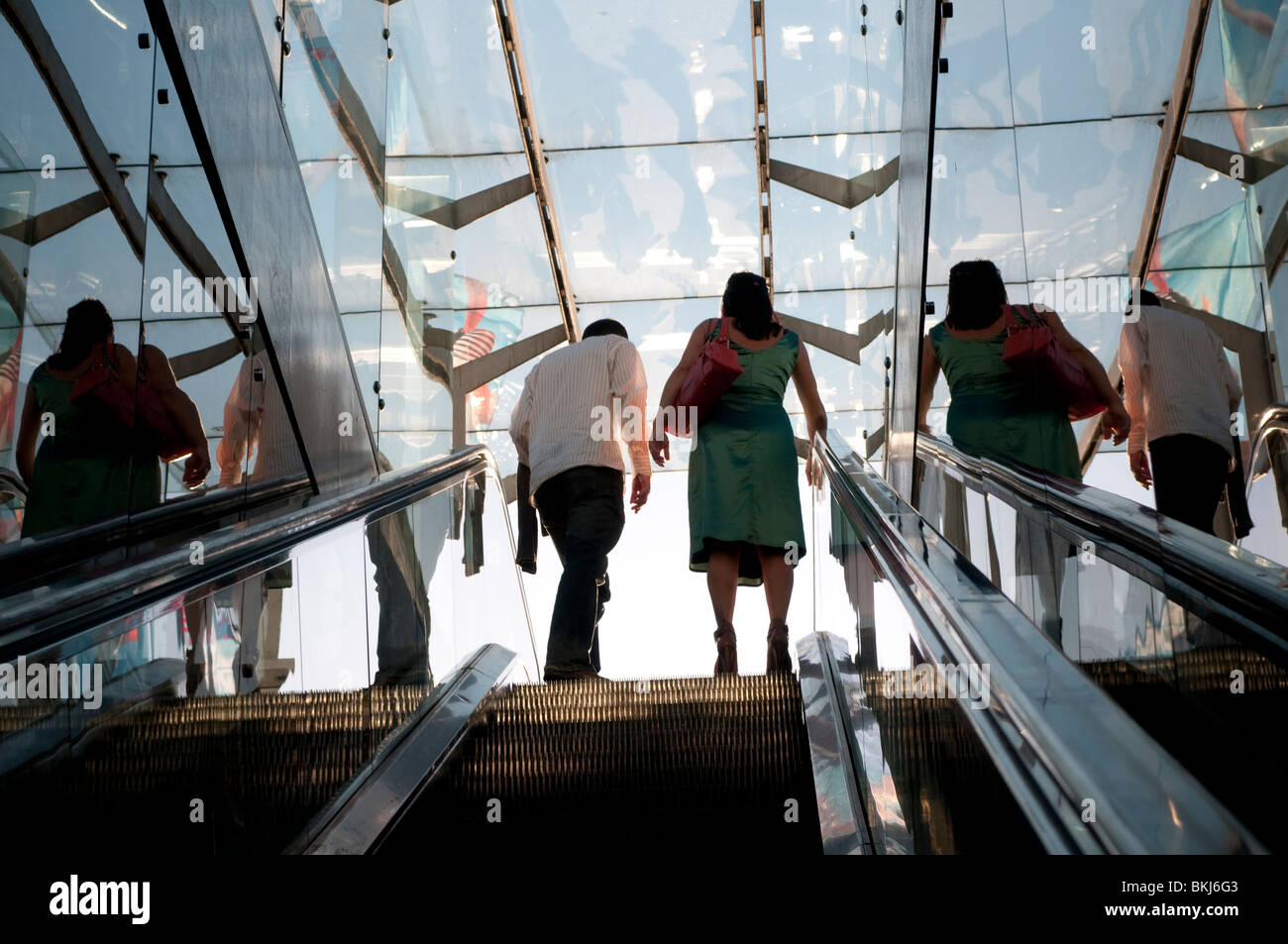 Couple at the top of the escalator, Sydney, Australia - Stock Image