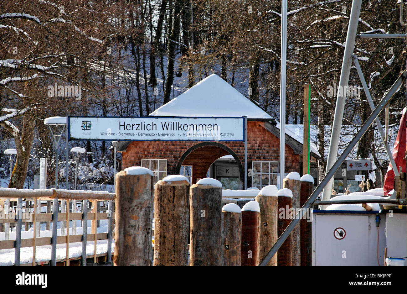 Welcome sign and pier to the Herren Island in winter, Chiemsee, Chiemgau Upper Bavaria Germany - Stock Image