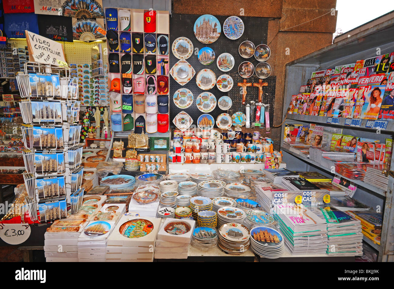 Kiosk selling postcards and tourist souvenirs at entrance to the Galleria Piazza del Duomo Milan Italy - Stock Image