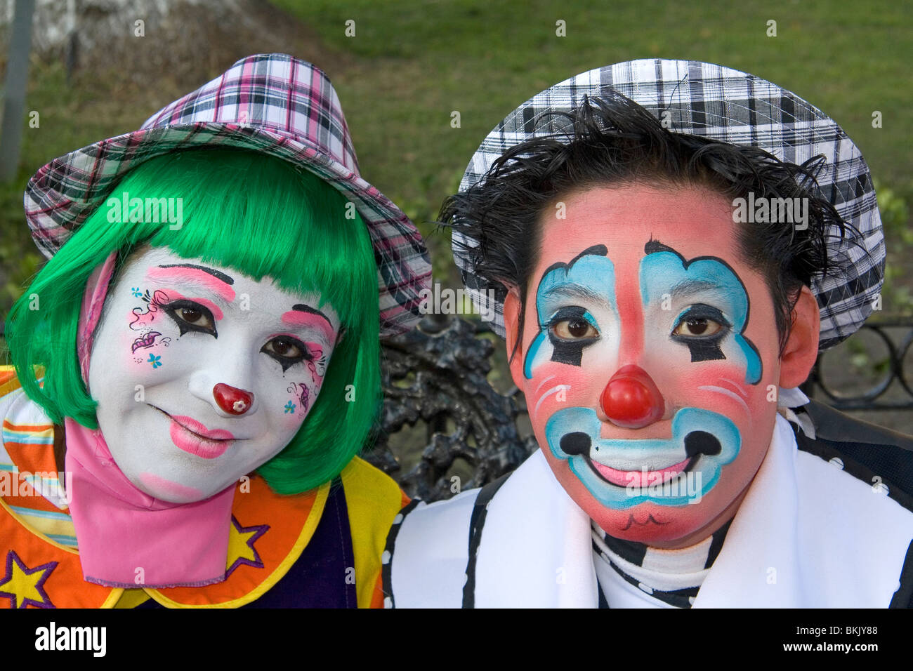 Male and female clown performers in the city of Puebla, Puebla, Mexico. - Stock Image