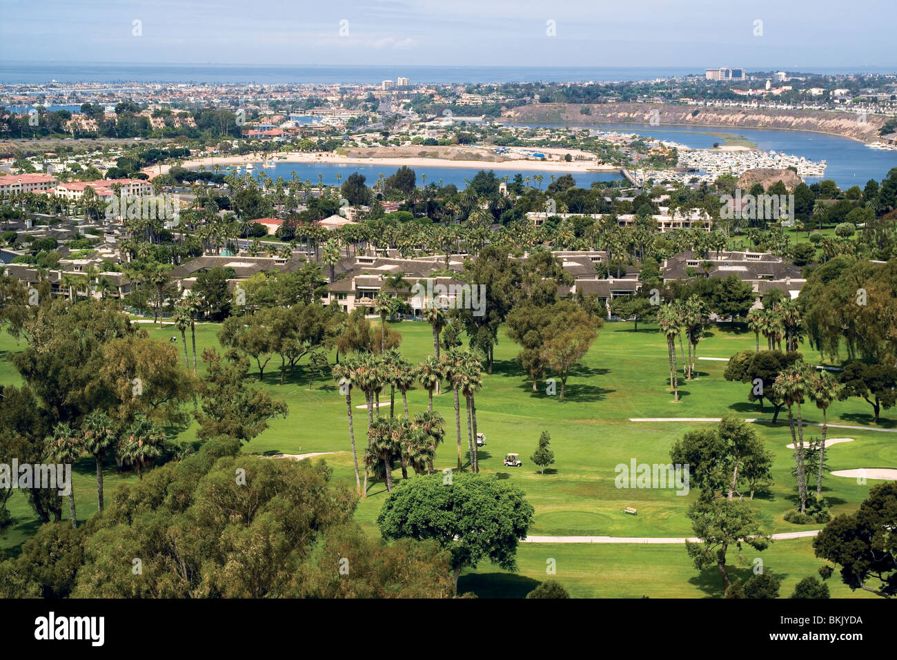 This scenic vista shows the Newport Beach Country Club golf links, the Back Bay and Pacific Ocean coastline in Newport - Stock Image