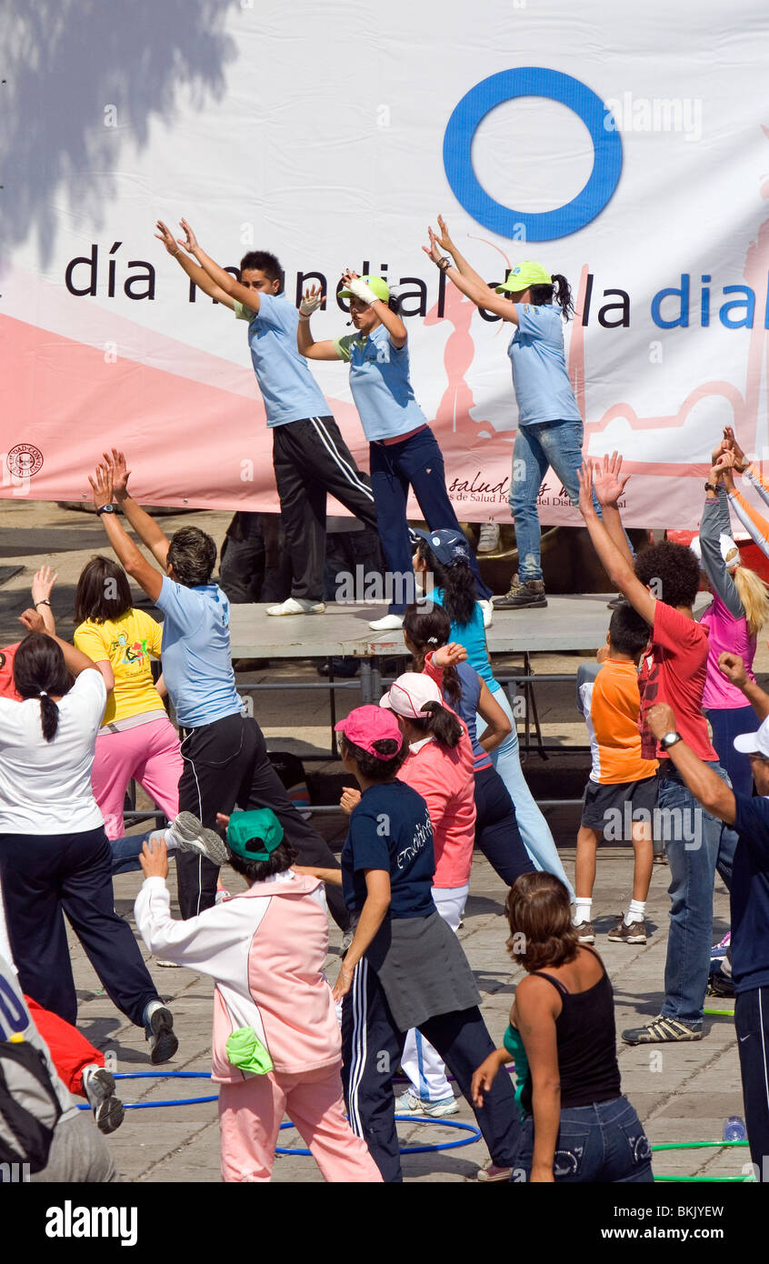 An organized group of people exercise for Diabetes awareness in Mexico City, Mexico. - Stock Image