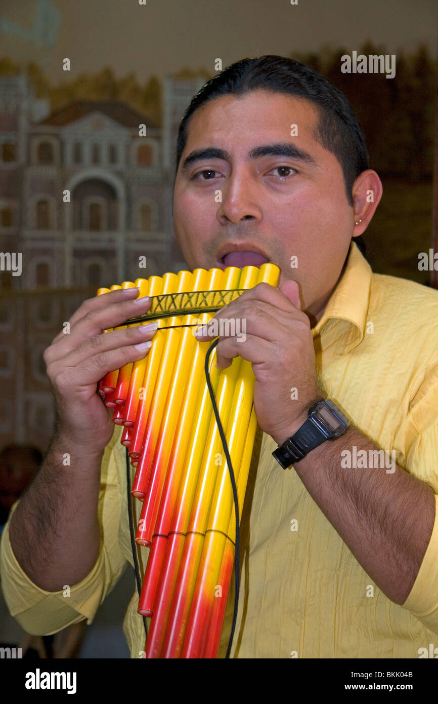 Musician playing a traditional panpipe in the city of Puebla, Puebla, Mexico. - Stock Image