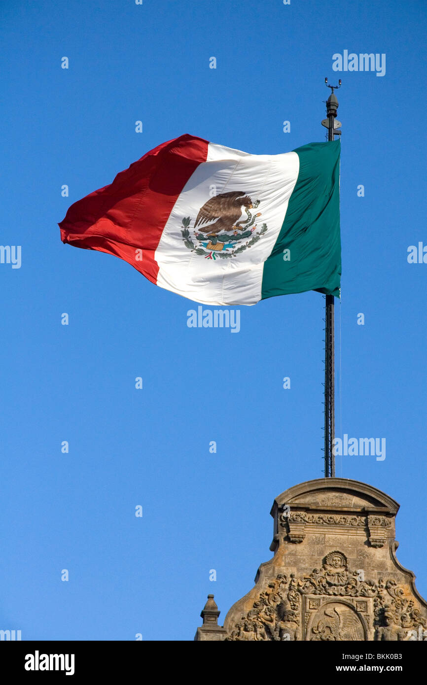 The Flag of Mexico atop the National Palace in Mexico City, Mexico. - Stock Image