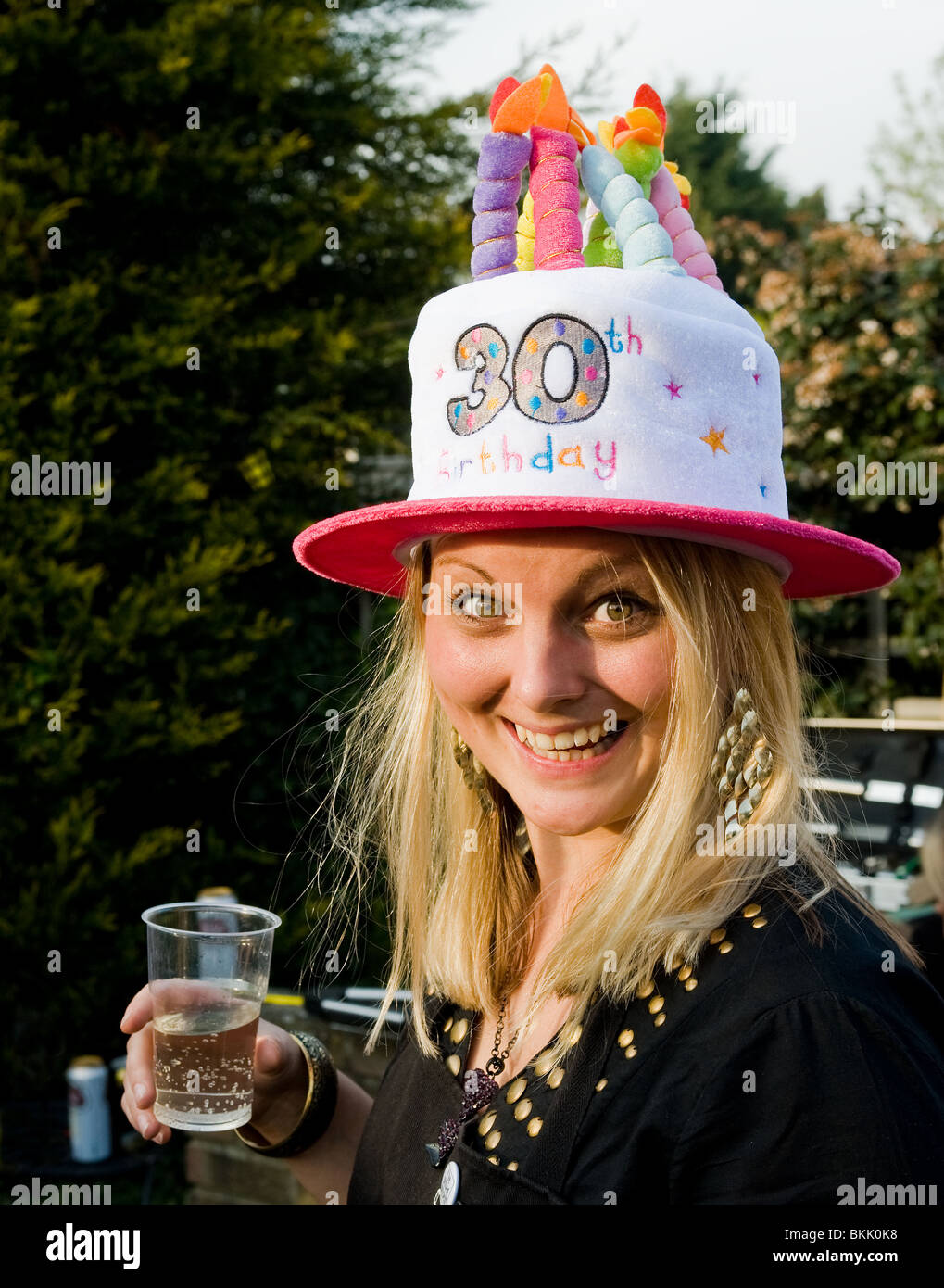 A Female Wearing Silly Hat Celebrating Her 30th Birthday