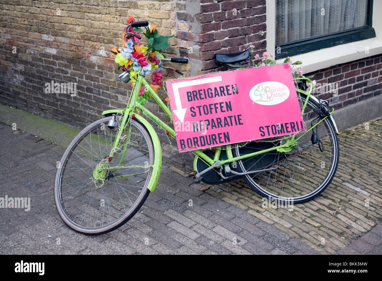 Colourful bicycle used to advertise, Texel, Netherlands, - Stock Image