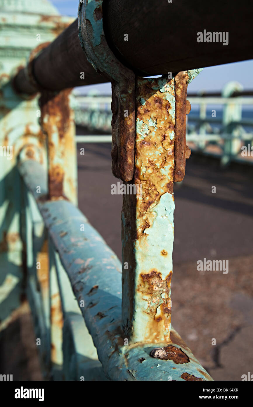 Rusty Victorian iron railings on sea front requiring maintenance Brighton England UK - Stock Image