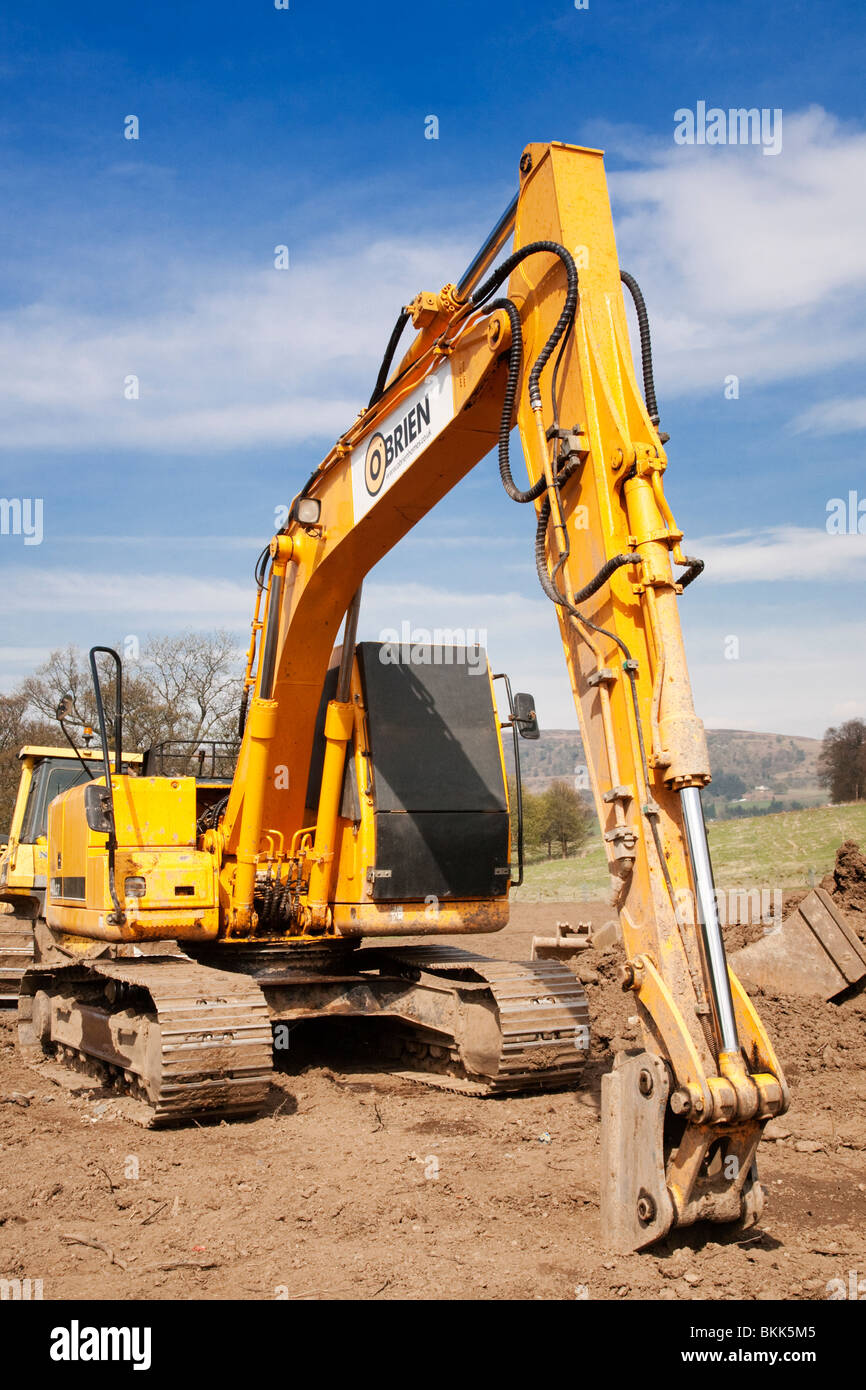 Hyundai 140LC-7 Robex Tracked Excavator with shutters over its windows on a construction site. - Stock Image