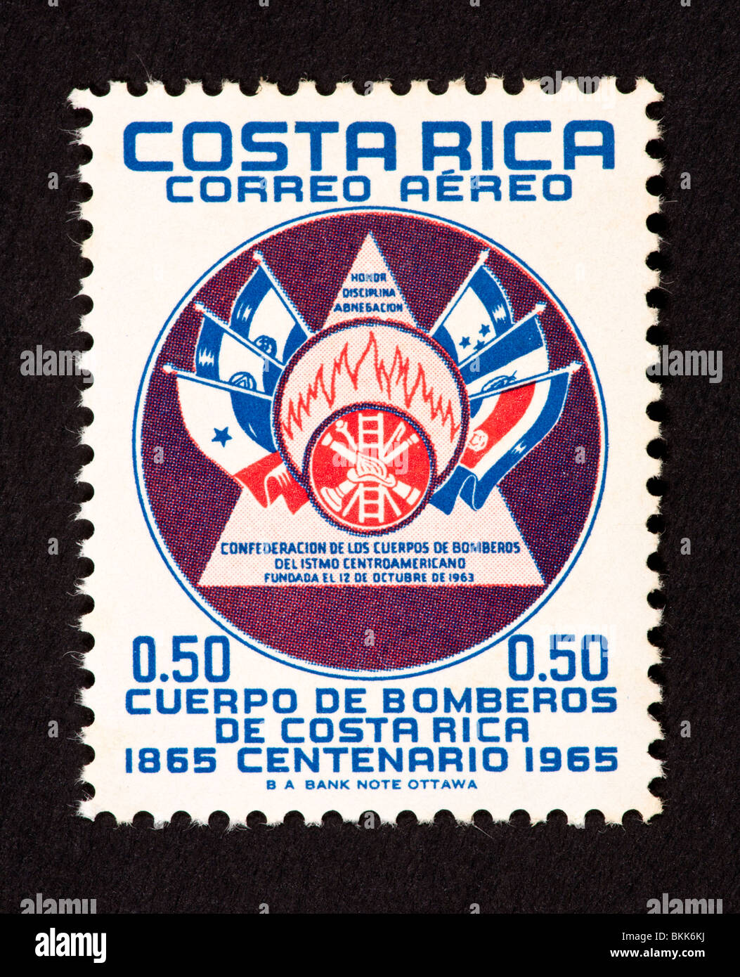 f7d807c9f0c8 Postage stamp from Costa Rica depicting the emblem and flags of the  Confederation of the Central American Fire Brigade