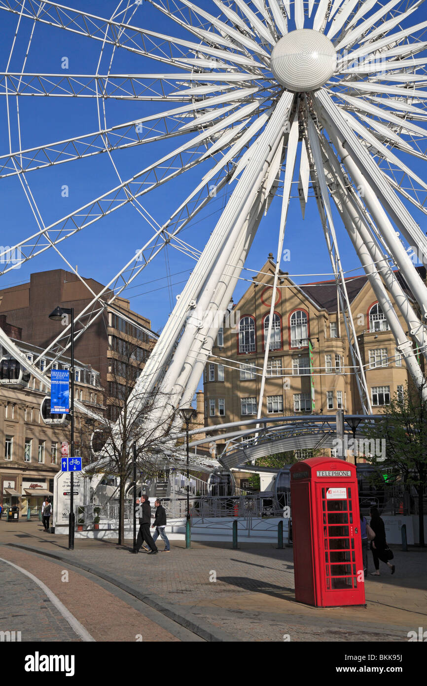 Detail of the Wheel of Sheffield with a red phone box in the foreground, Sheffield, South Yorkshire, England, UK. - Stock Image