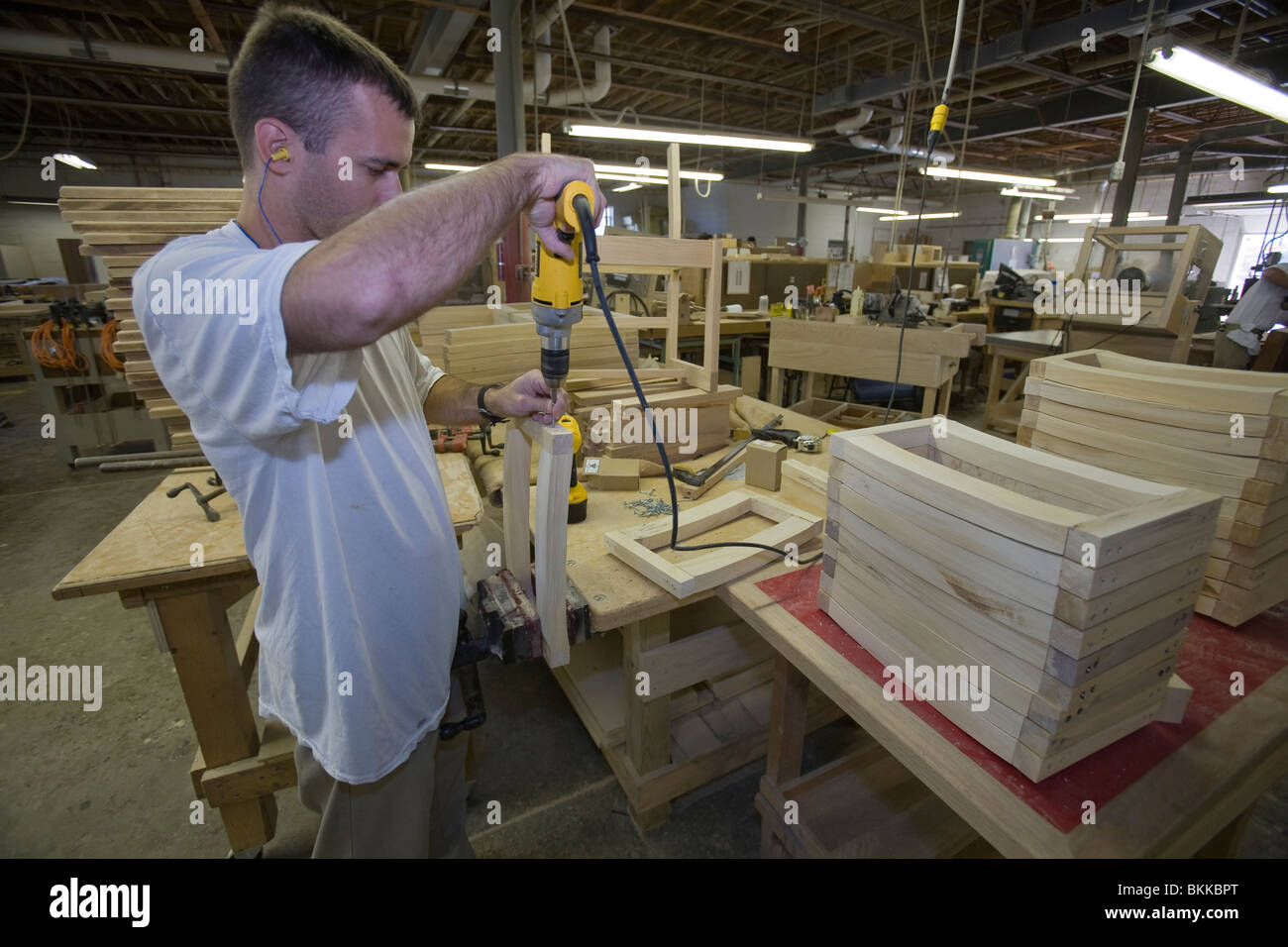 Inmate working in the manufacturing wood shop inside the Nebraska State Penitentiary. - Stock Image