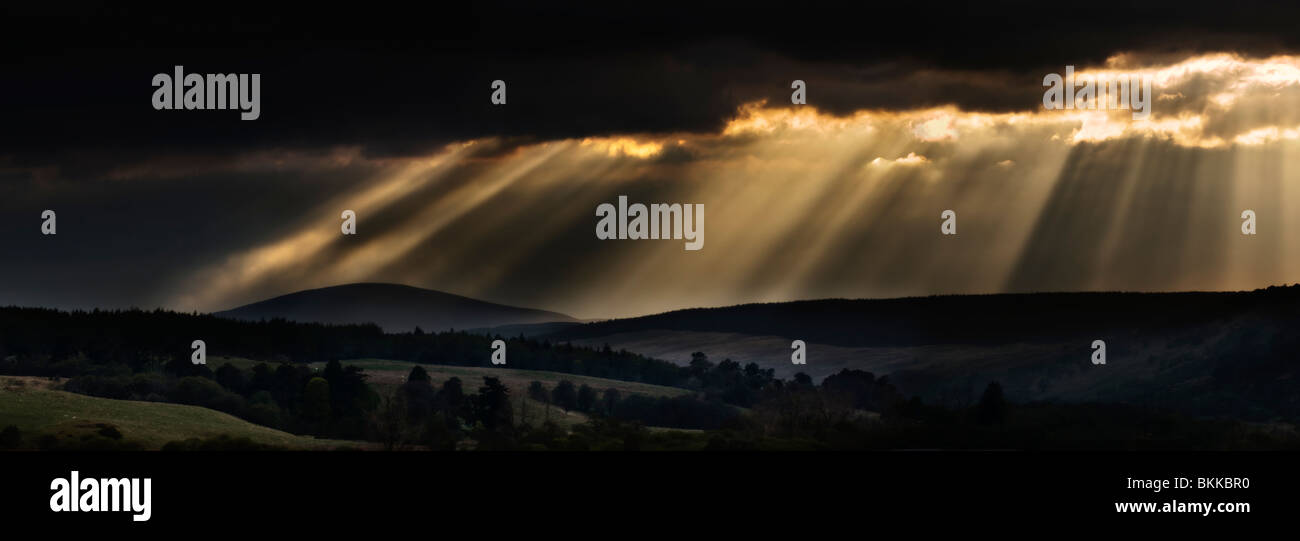 Sunrays breaking through stormy sky, taken early evening near Invershin, looking towards the Kyle of Sutherland, - Stock Image