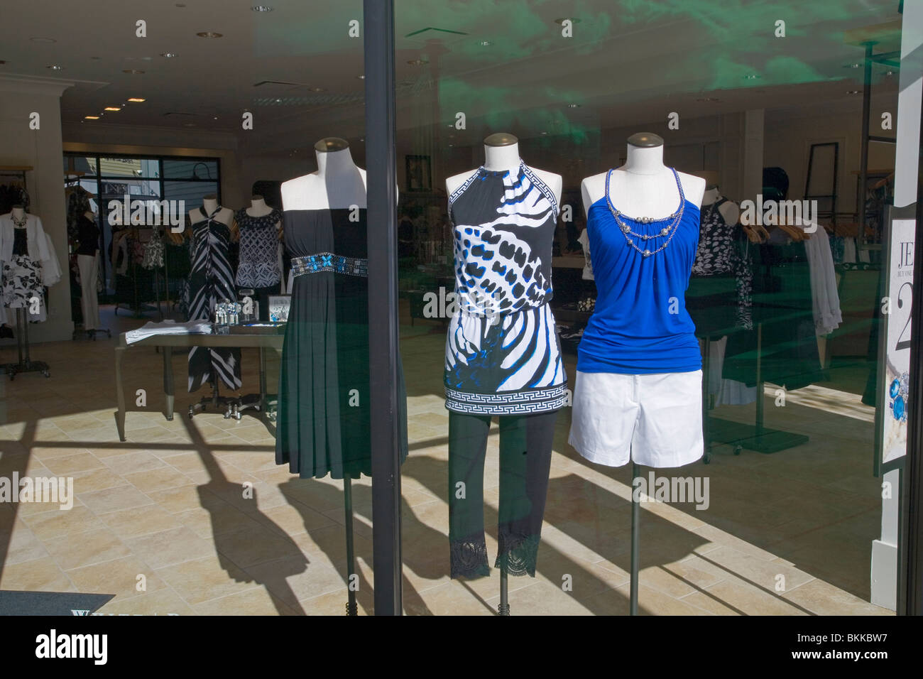 Mannequins in a store shop window in a large western shopping mall - Stock Image
