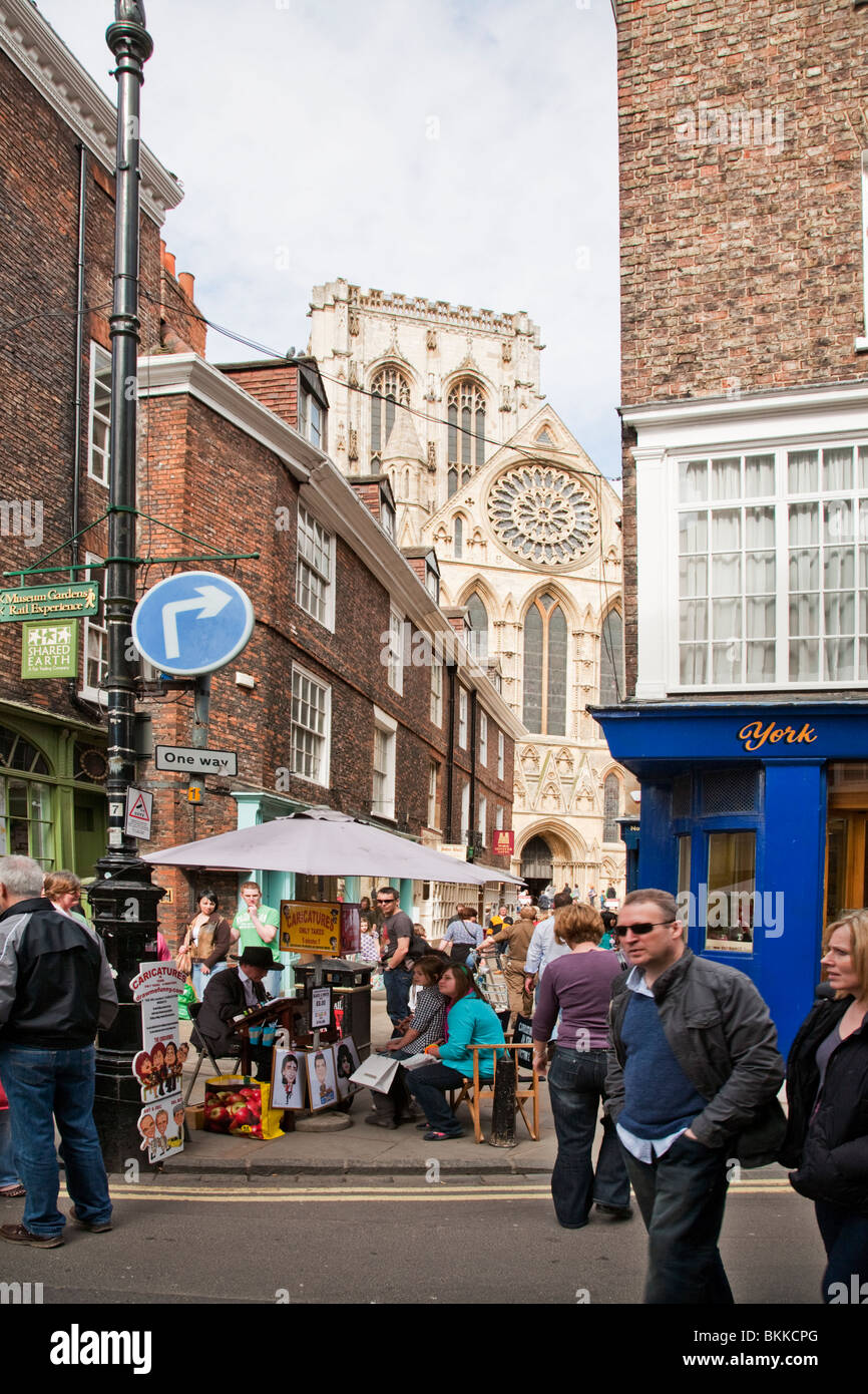 View along the busy city centre streets towards York Minster, York, Yorkshire, Uk - Stock Image