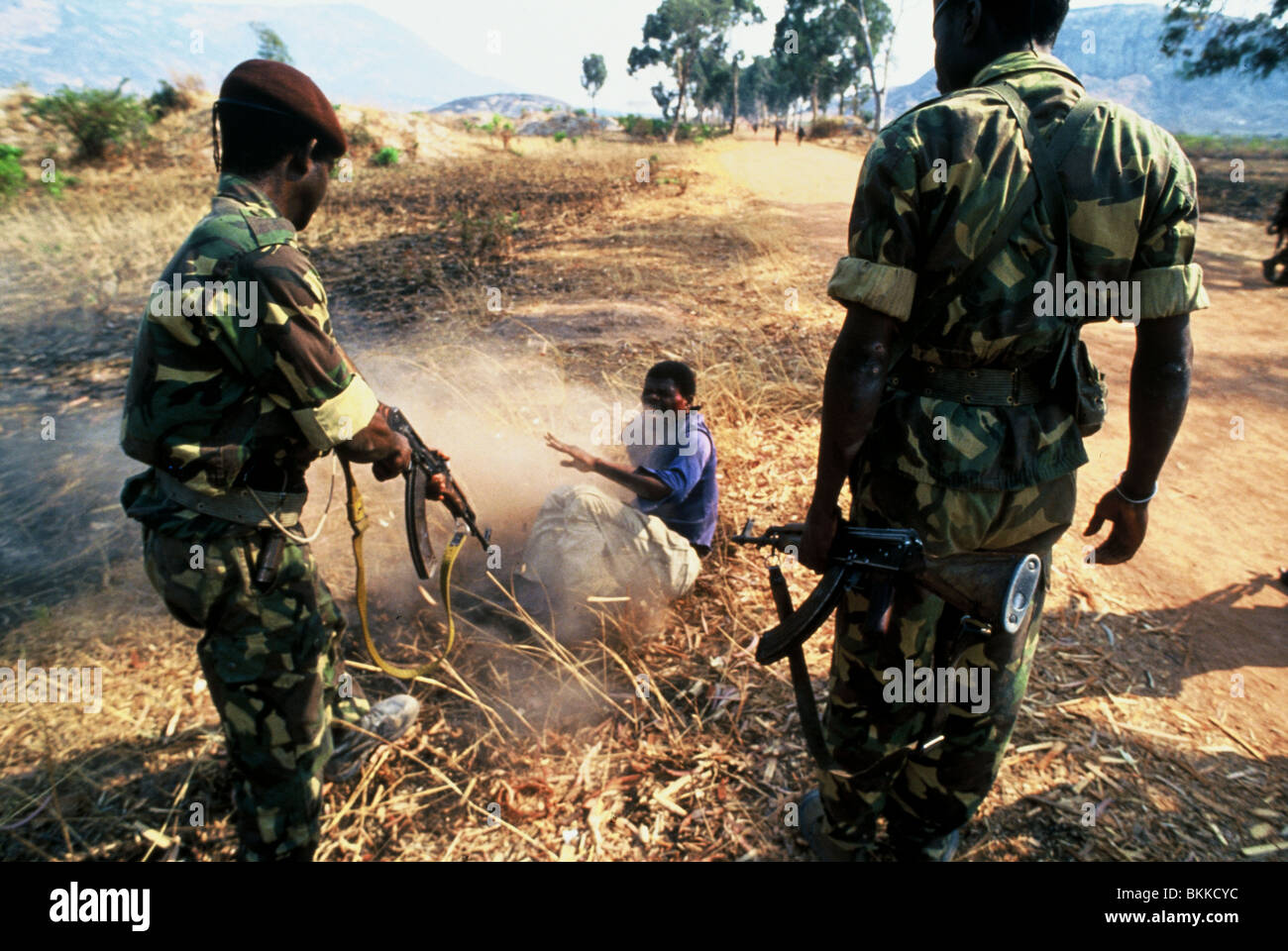 A young man is beaten by MPLA soldiers during Angola's long running civil war. - Stock Image