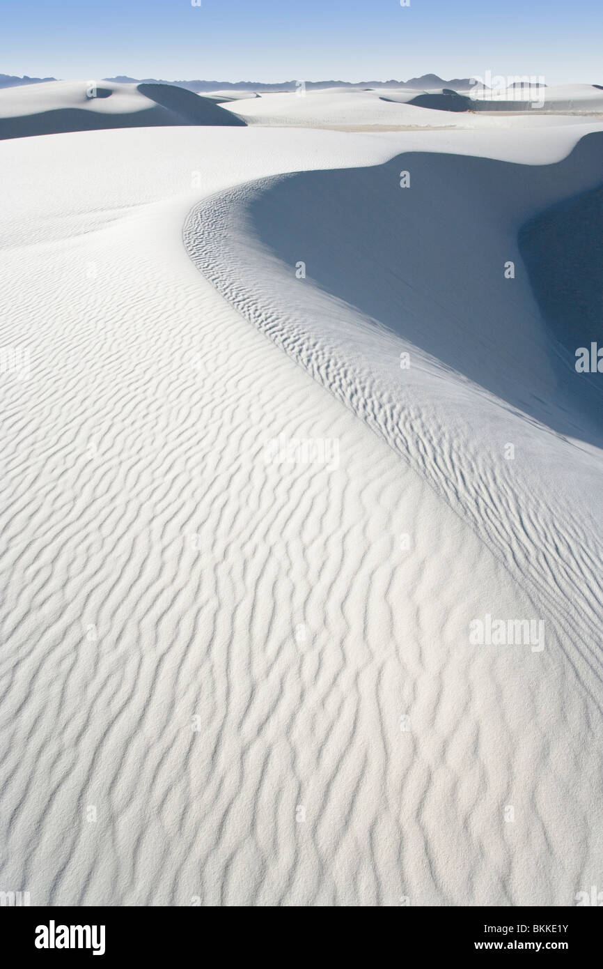 Ripples made by the wind on a large white sand dune at White Sands National Monument, New Mexico. - Stock Image