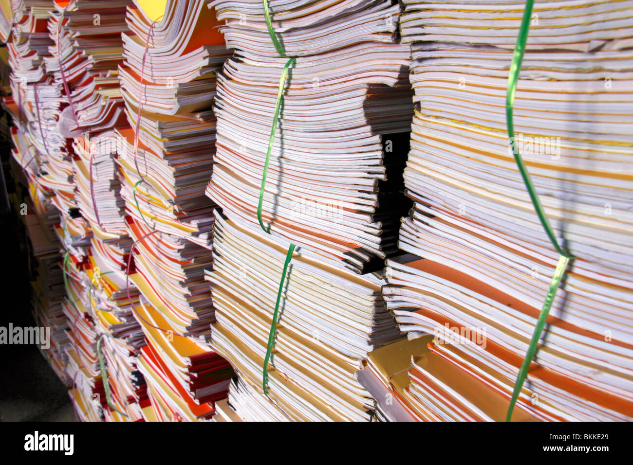 An image of a large stack of documents & files waiting to be processed. - Stock Image