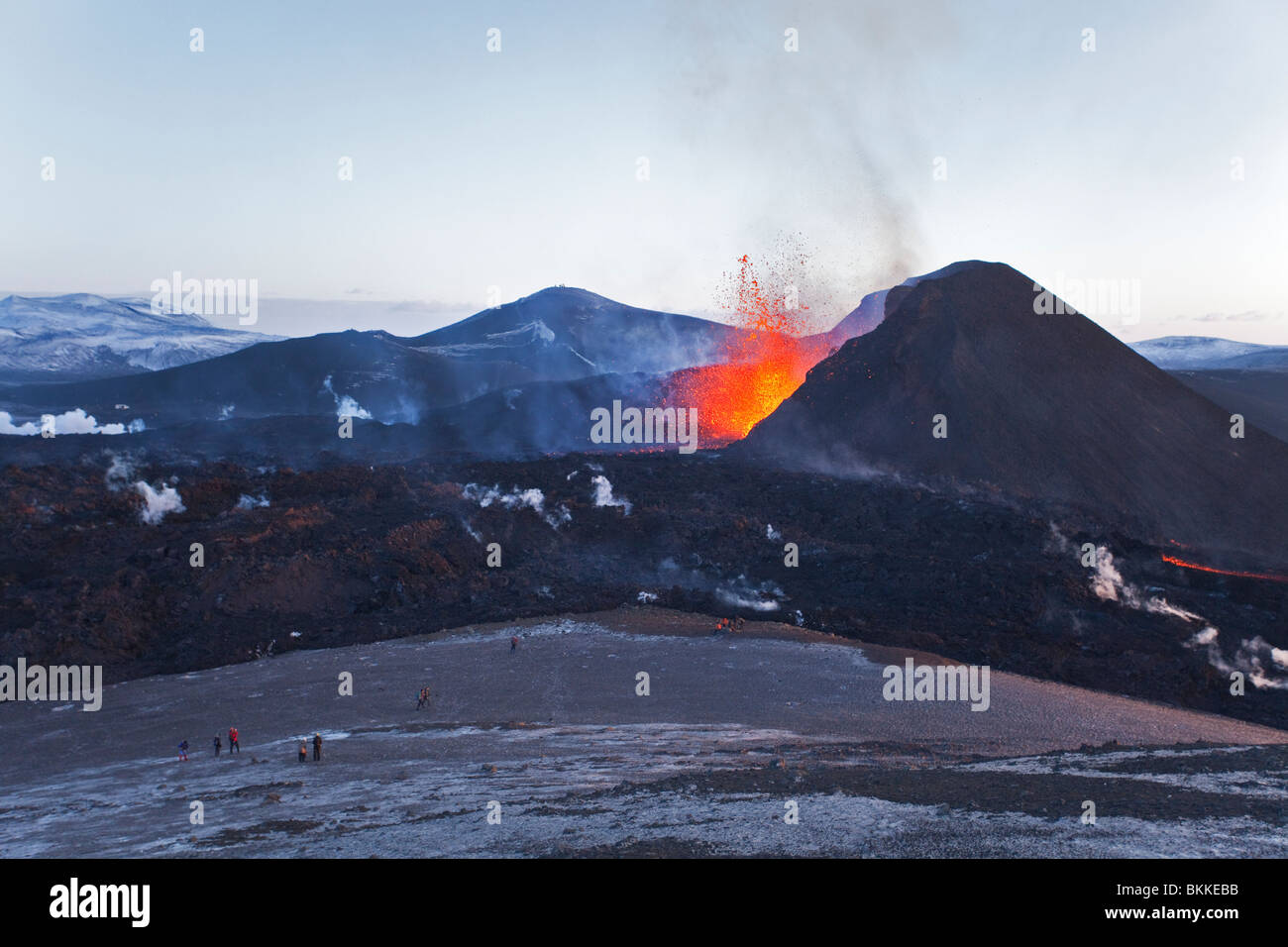 Many tourists and hikers are watching lava flows and lava fountains from the Iceland 2010 eruption of the Eyjafjalla - Stock Image