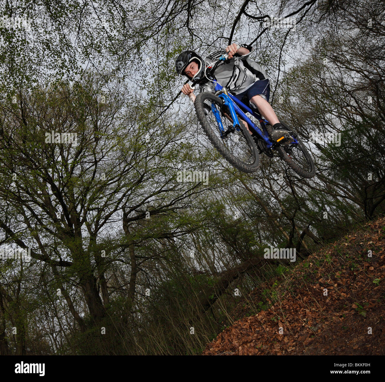 Freeriding dirt bike jumper. - Stock Image