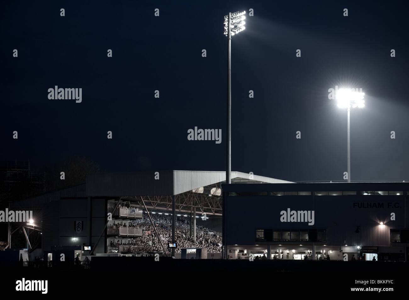 A section of the Fulham FC football ground, Craven Cottage, during an evening match on the banks of London's - Stock Image