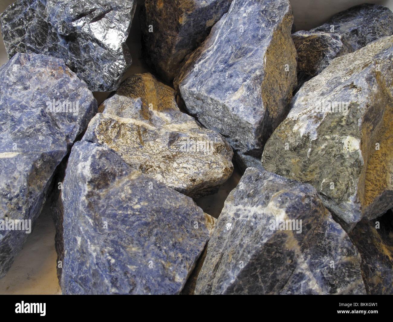 Collection of raw semi-precious stone mineral Sodalite (Sodium Aluminum Silicate Chloride) - Stock Image