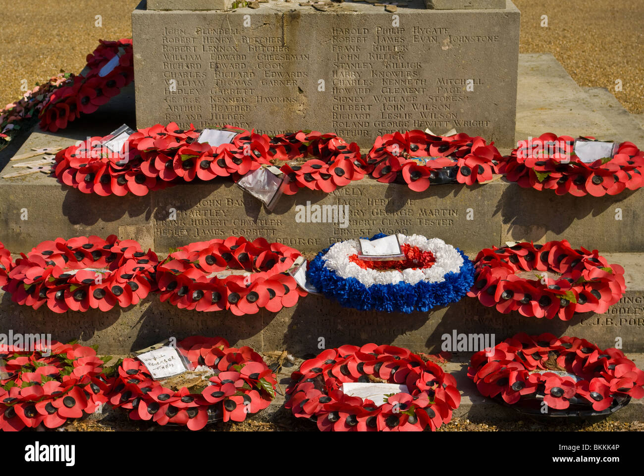 Poppy Wreaths At The Base OF A War Memorial - Stock Image