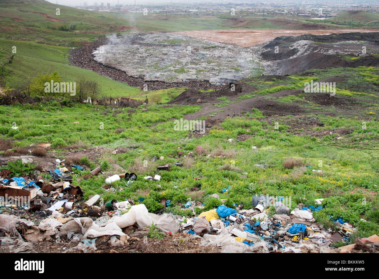 Methane gas processing landfill area in Republic of  Armenia where the landfill always smokes itself - Stock Image