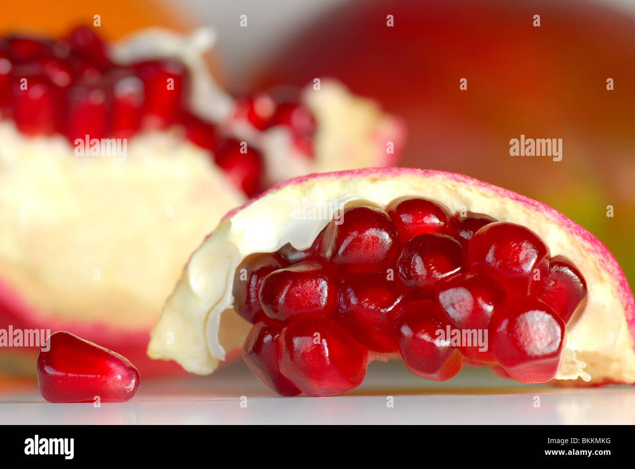 Pomegranate extremely close with soft background - Stock Image