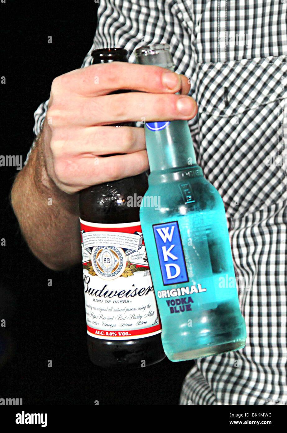 Man drinking wkd original and budweiser - Stock Image