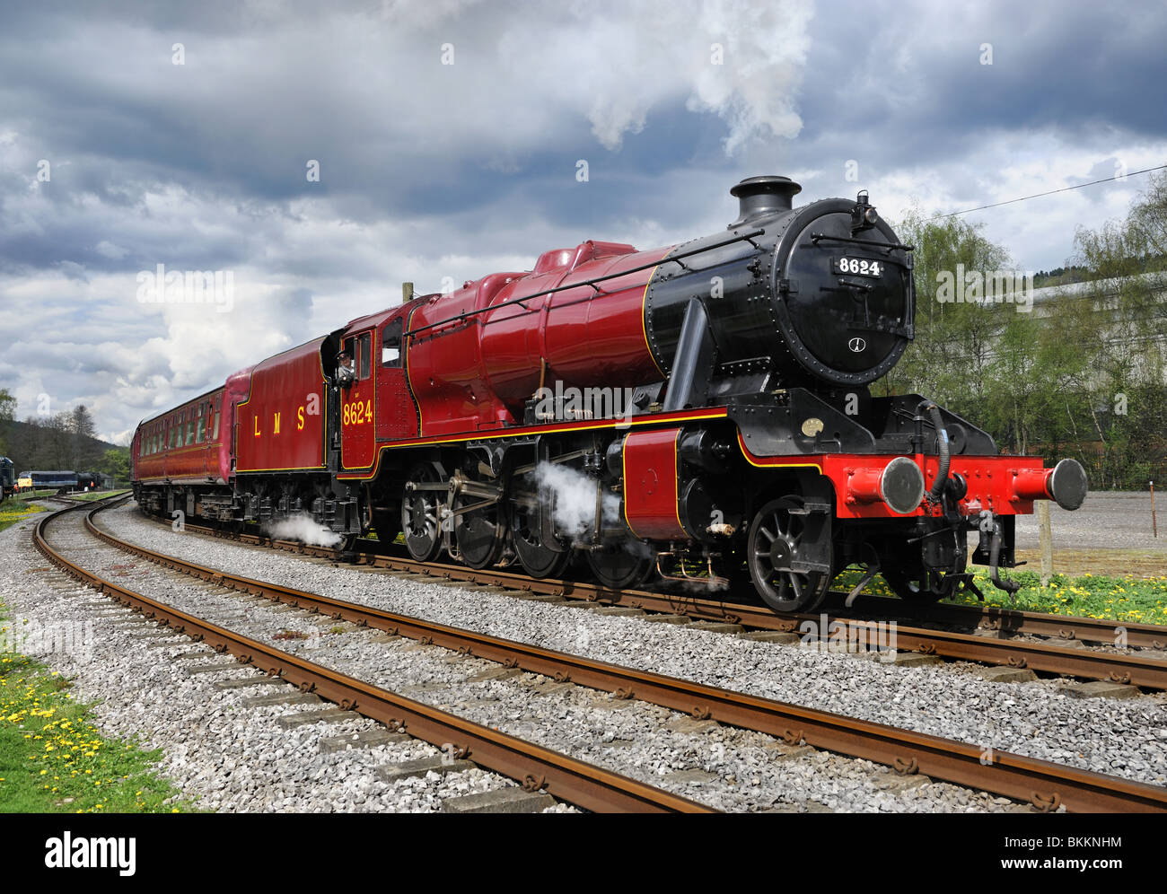 1943 Stanier 8F Steam Locomotive, No.8624, with train of carriages, Peak Rail centre, South Rowsley, Derbyshire. - Stock Image