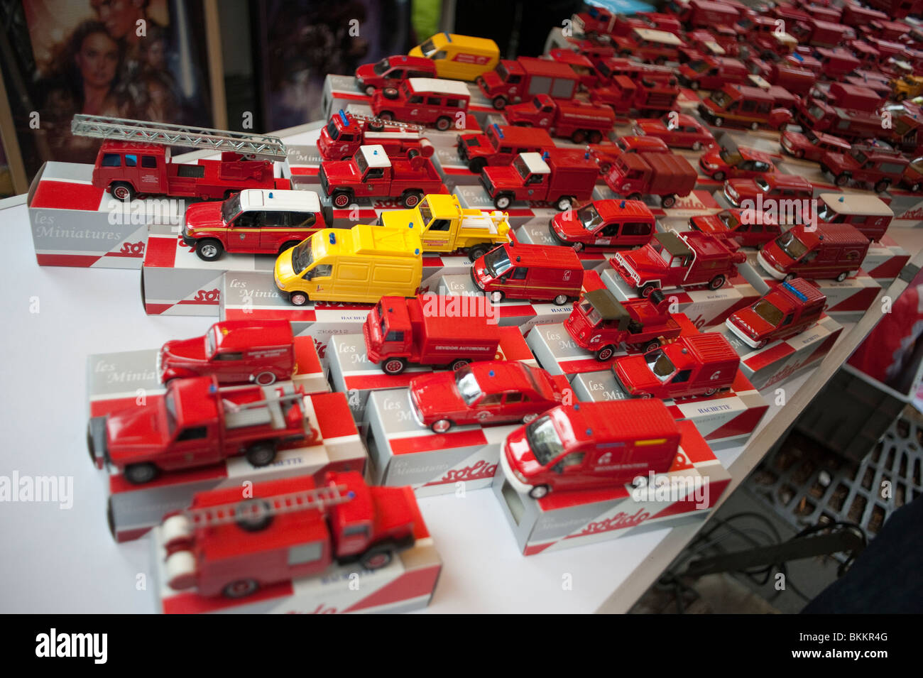 Antique Metal Toy Cars On Display In Garage Sale Paris France