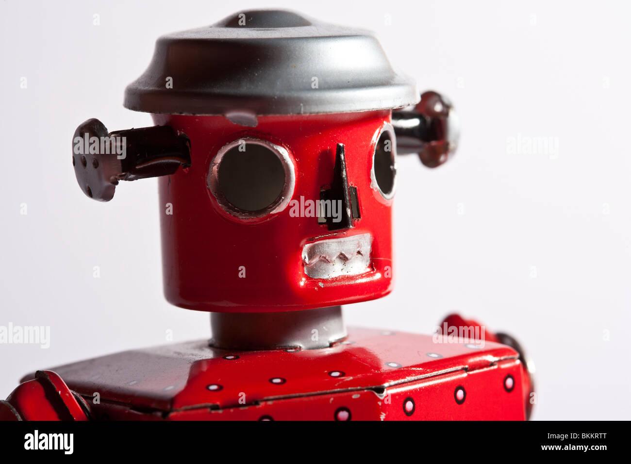 Retro red tinplate toy robot - Stock Image