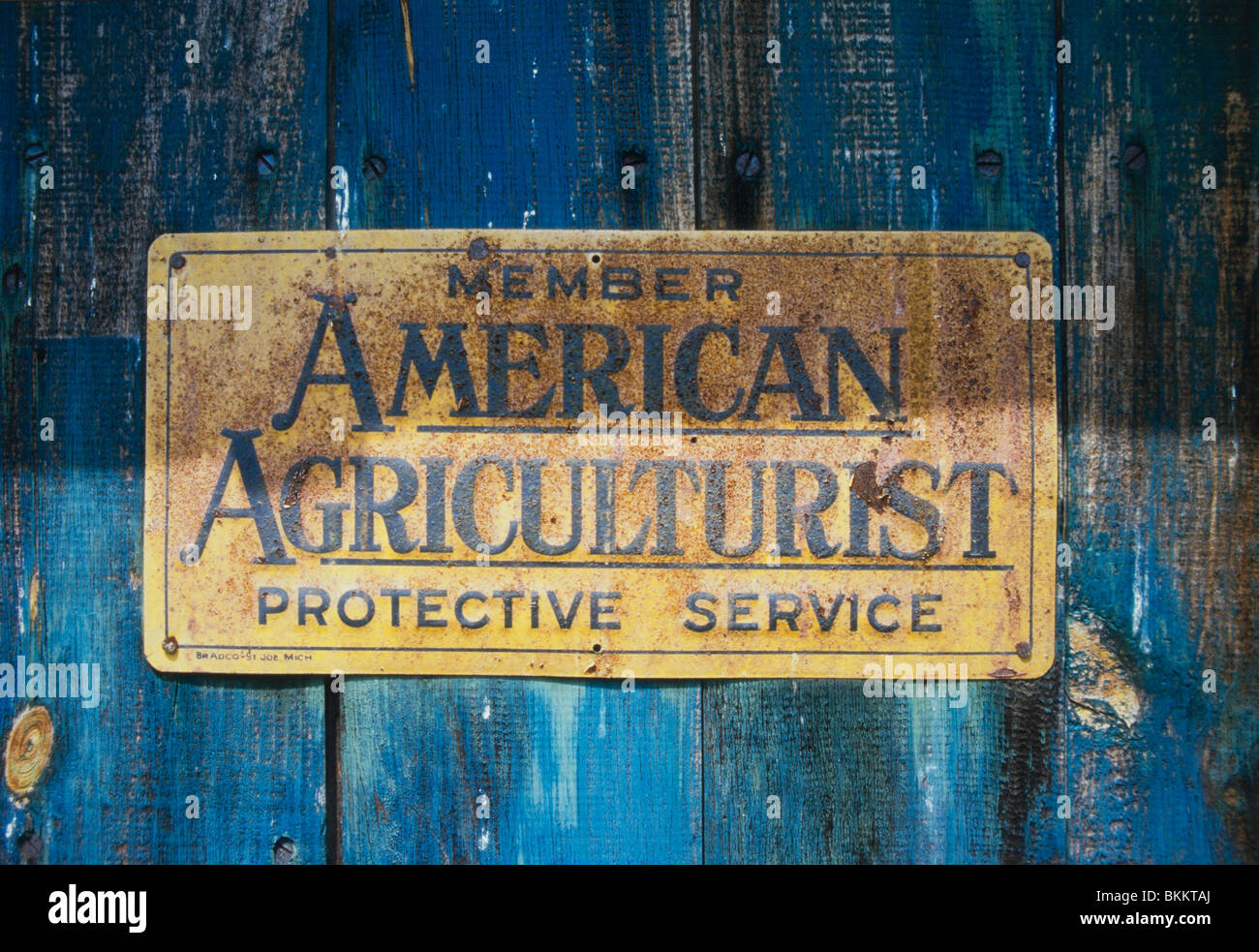 Old 'American Agriculturist' insurance enamelled metal plaque on an old barn in Cambridge, New Hampshire, - Stock Image