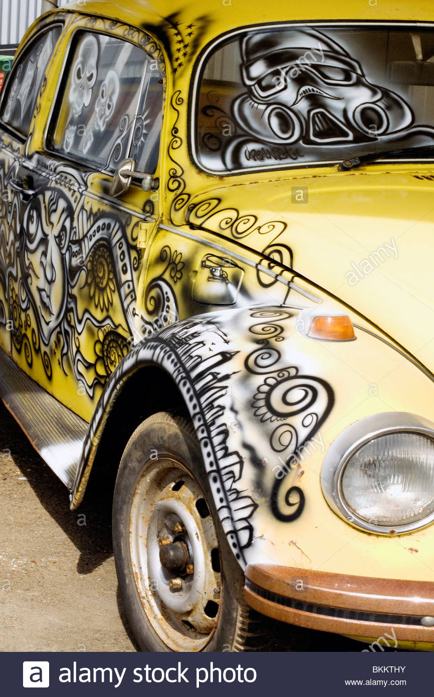 A Volkswagen Beetle Spray Painted with Graffiti Art Stock Photo
