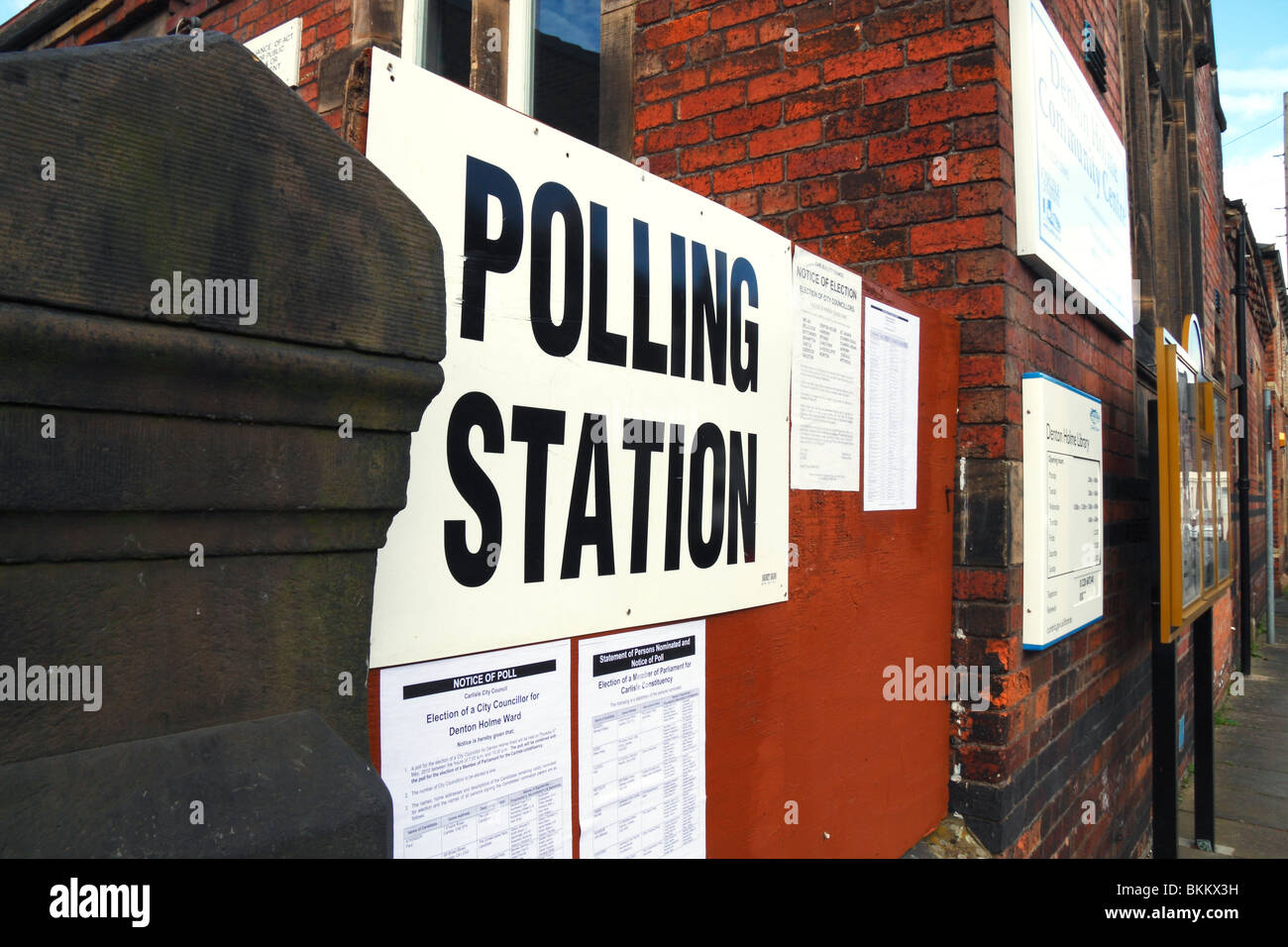Polling station sign with notices outside a community centre in the UK - Stock Image