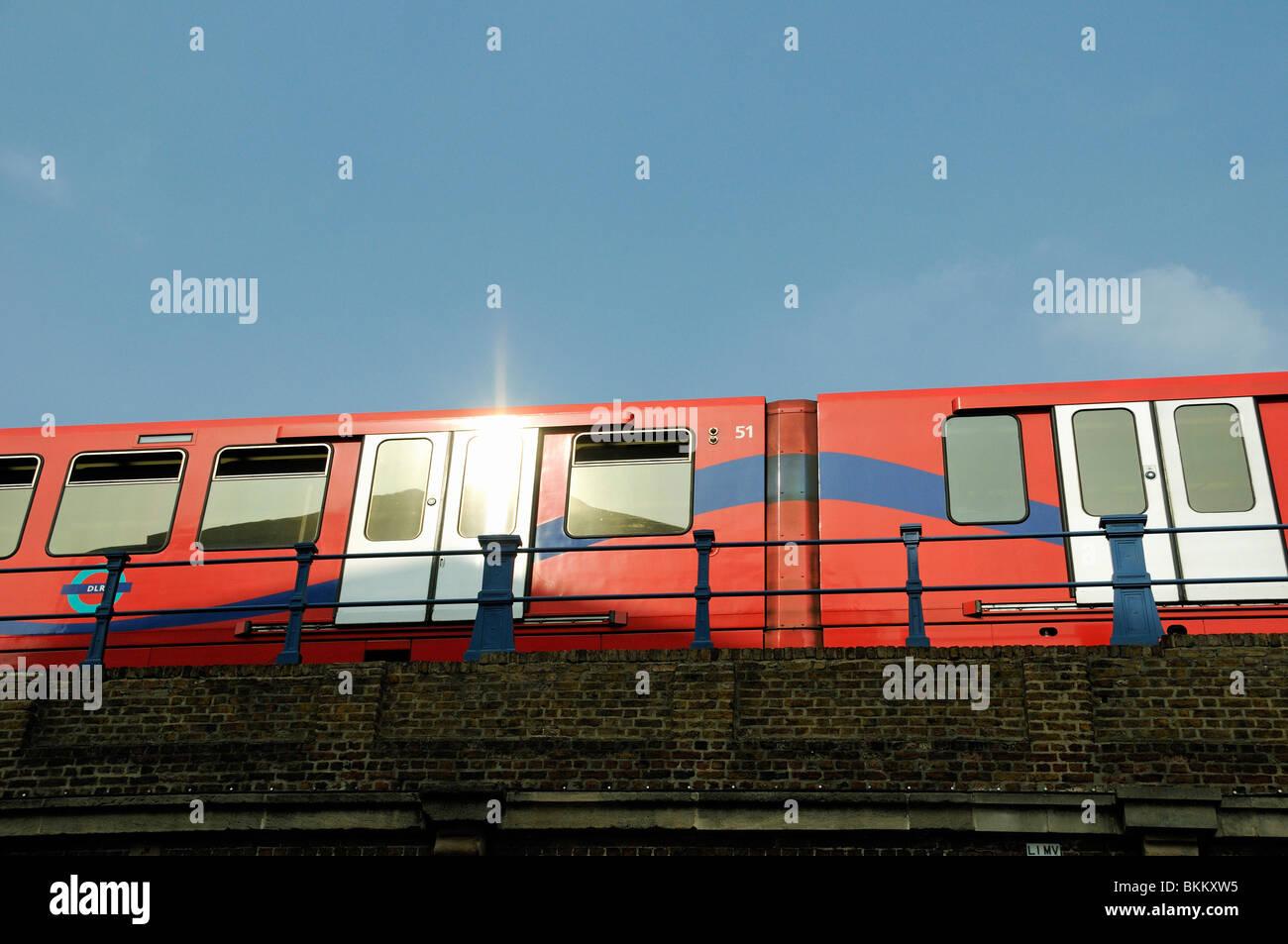 Docklands Light Railway DLR train against blue sky Limehouse Poplar London England UK - Stock Image