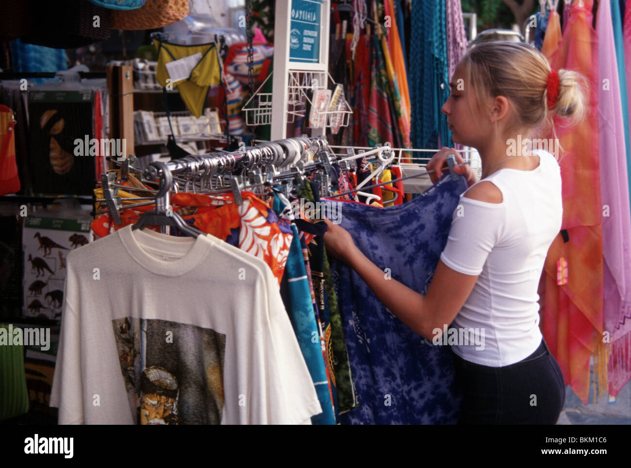 Teenage girl shopping for clothes in Greece - Stock Image