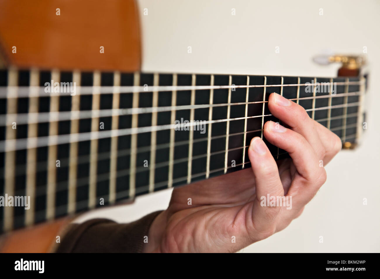 Nylon String Classical Guitar Close Up With Left Hand Fingering The