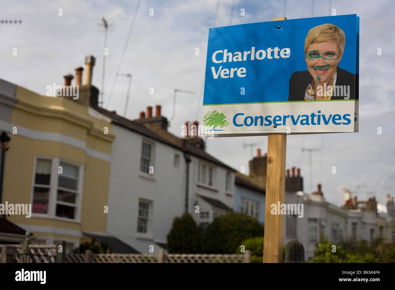 Defaced Conservative candidate election sign in Brighton's Pavillion constituency. - Stock Image