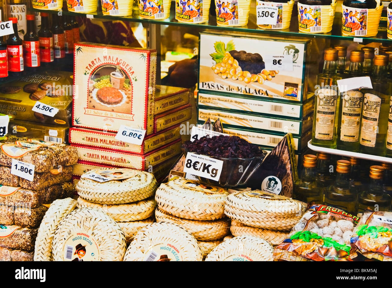 Costa Del Sol, Malaga, Spain; Wines, Dried Fruit And Cake Displayed In A Malaga Shop Window - Stock Image