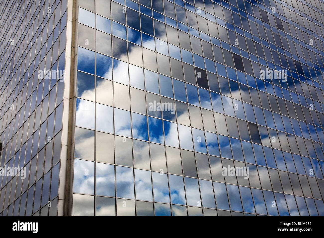 Montreal, Quebec, Canada; Blue Sky And Clouds Reflected In A Glass Office Tower Building - Stock Image