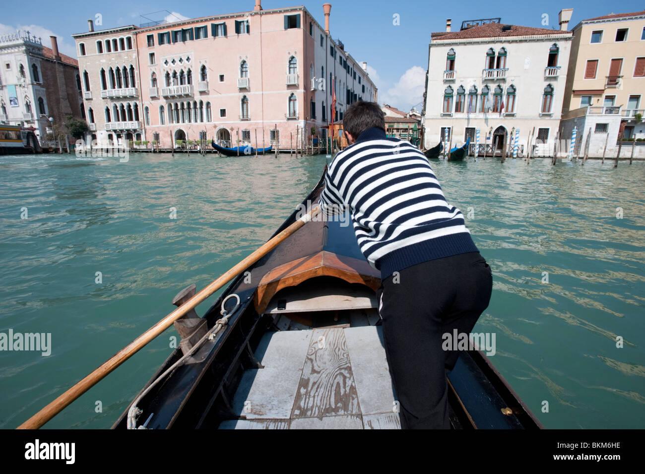 Gondolier of public ferry Traghetto gondola crossing the Grand Canal in Venice - Stock Image