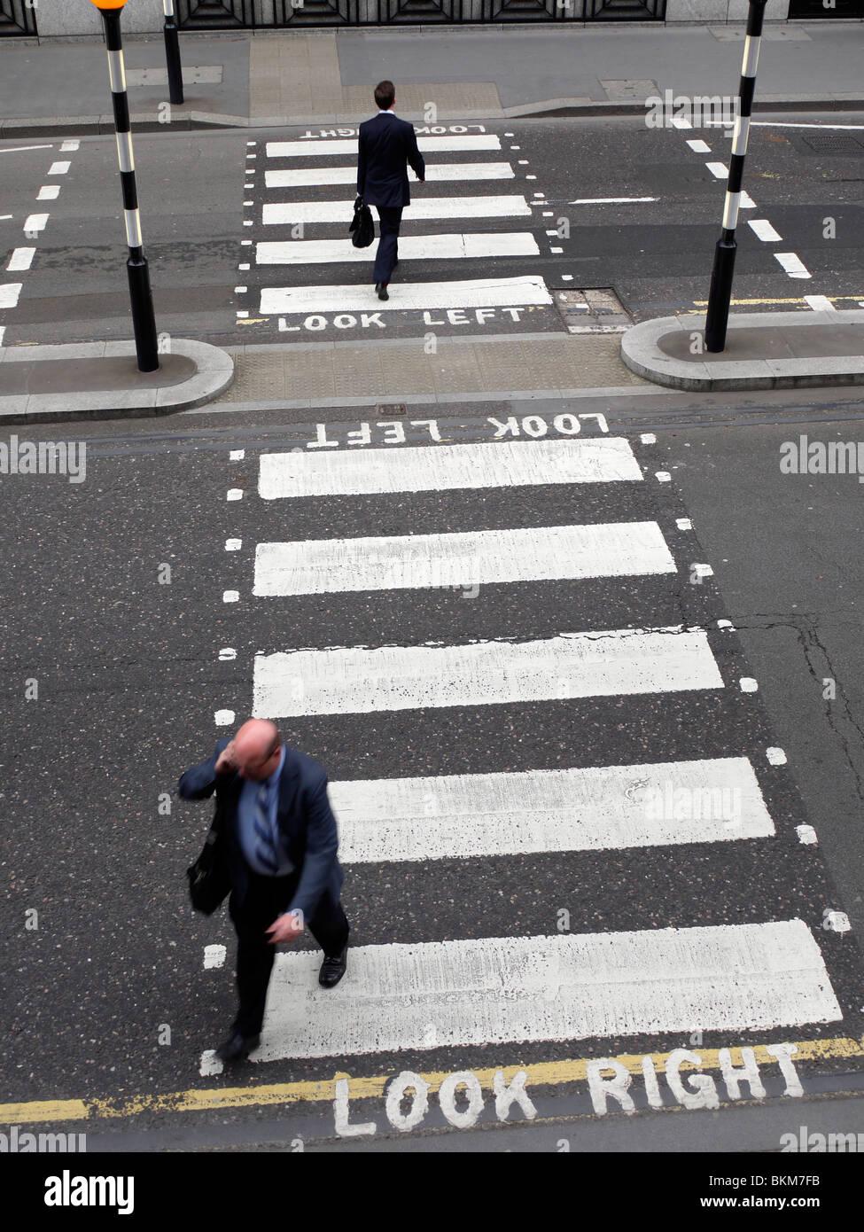 zebra pelican crossing, with commuters crossing Stock Photo
