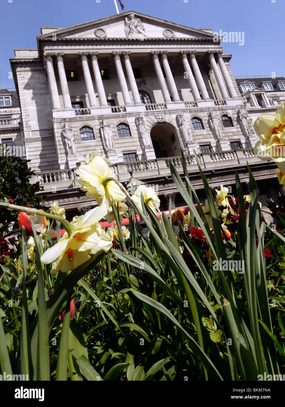 bank of england, with flower bed depicting green shoots of recovery, growth - Stock Image
