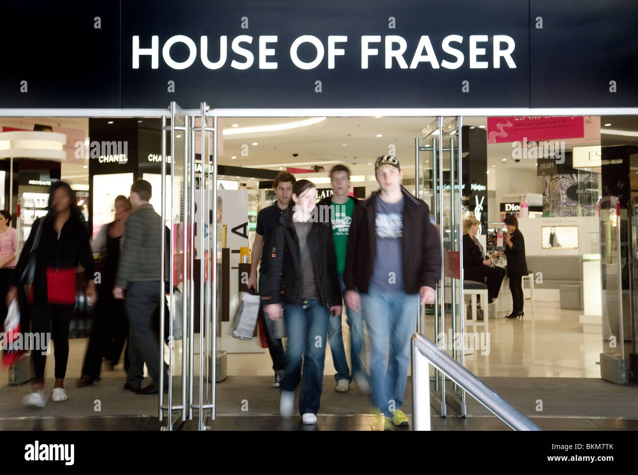 Shoppers coming out of the House of Fraser store, Oxford Street, London UK - Stock Image