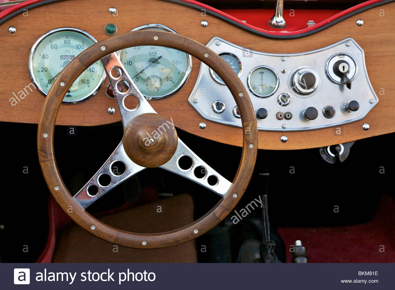 Dashboard and steering wheel of a MG T-Type antique car from the early 1950's. Leipzig, Germany. - Stock Image