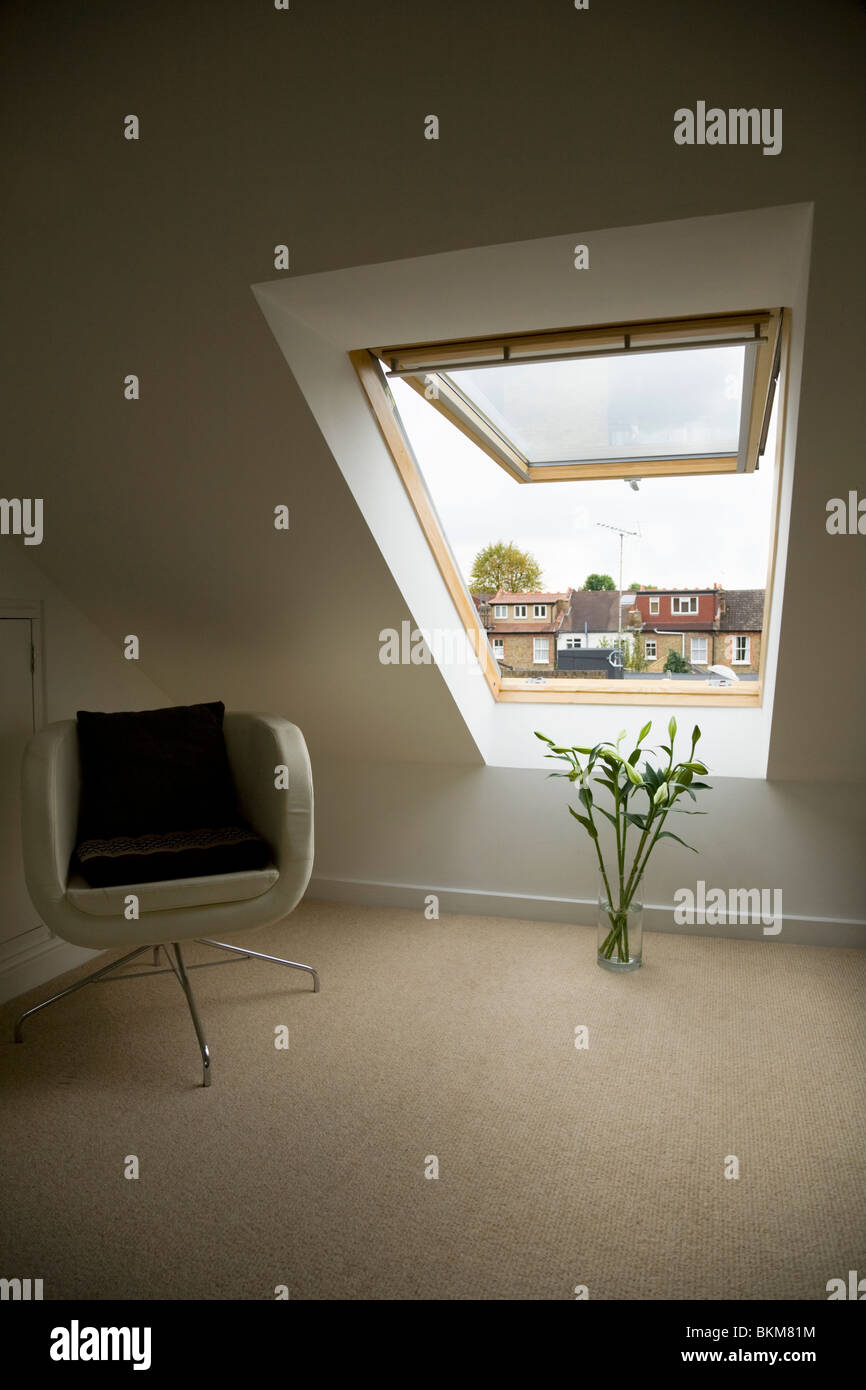 Velux window in a dormer roof / attic / loft conversion in a Victorian terraced house in Twickenham. UK & Velux window in a dormer roof / attic / loft conversion in a Stock ...