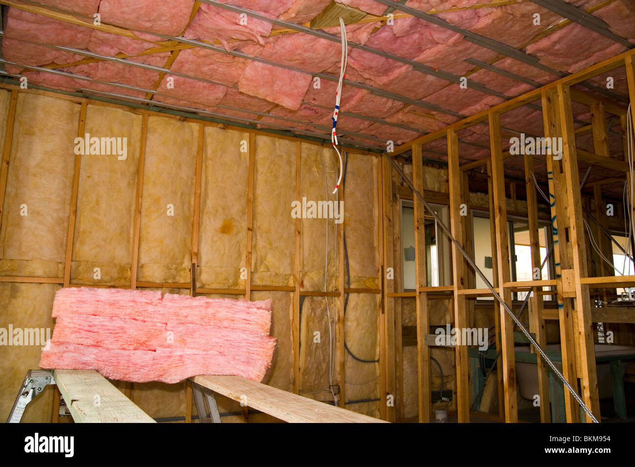 fiberglass insulation in walls and ceiling of a new home ...