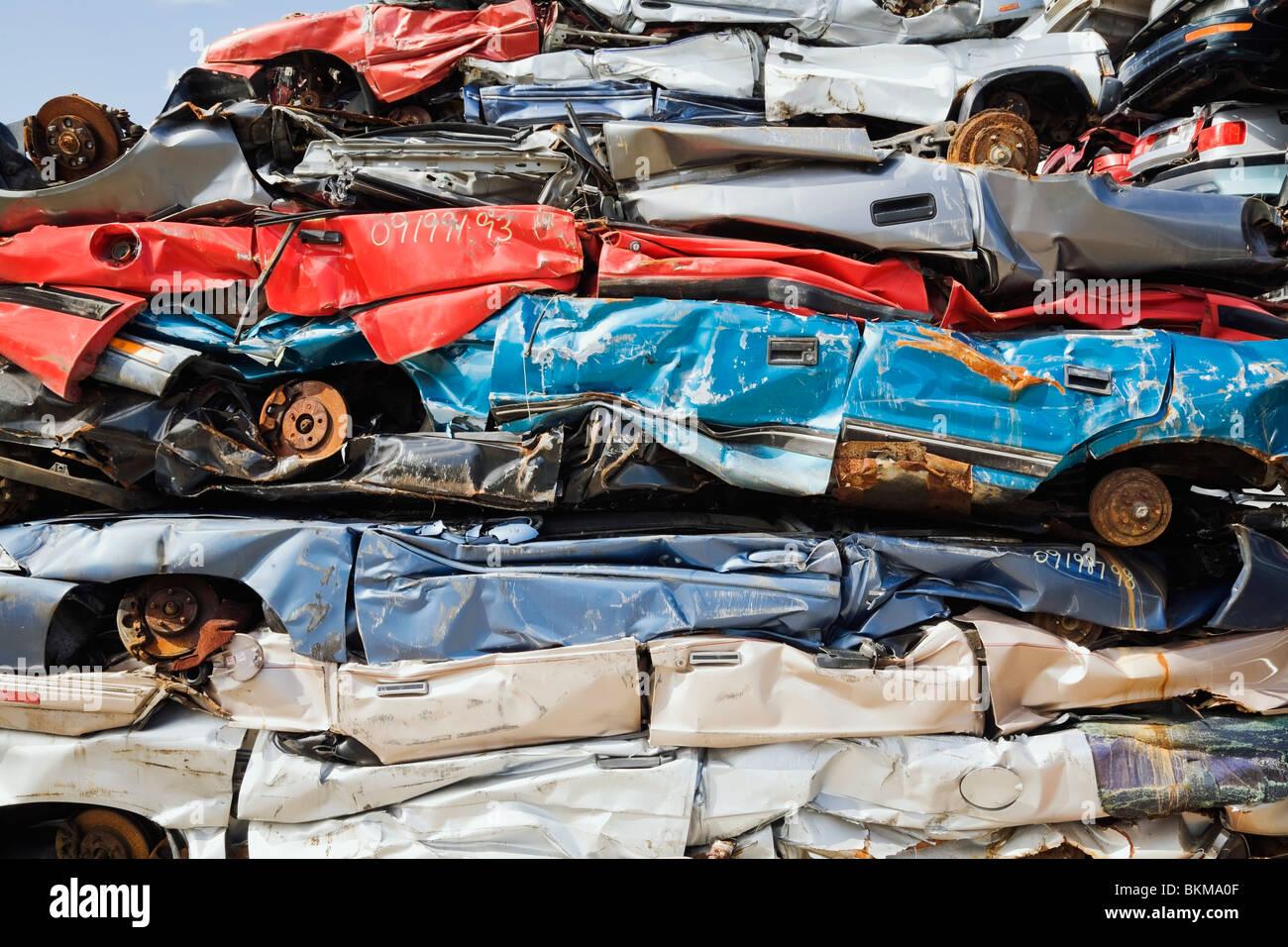Quebec, Canada; Stacked And Crushed Automobiles At A Scrap Metal Recycling Junkyard Stock Photo
