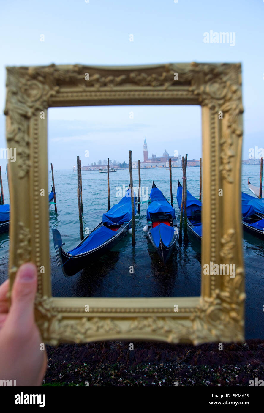 Grand Canal and gondolas at dawn framed within picture frame in Venice Italy - Stock Image
